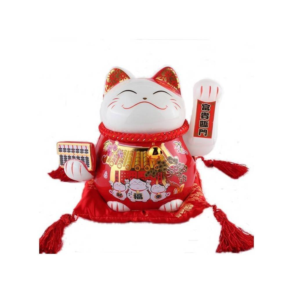 Le chat japonais Maneki Neko agite la patte gauche pour vous apporter bonheur, richesse et prospérité